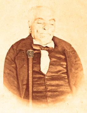 Don Miguel Durá Garcñes, en su lecho de muerte, fotografiado con su vara de alcalde. 1867